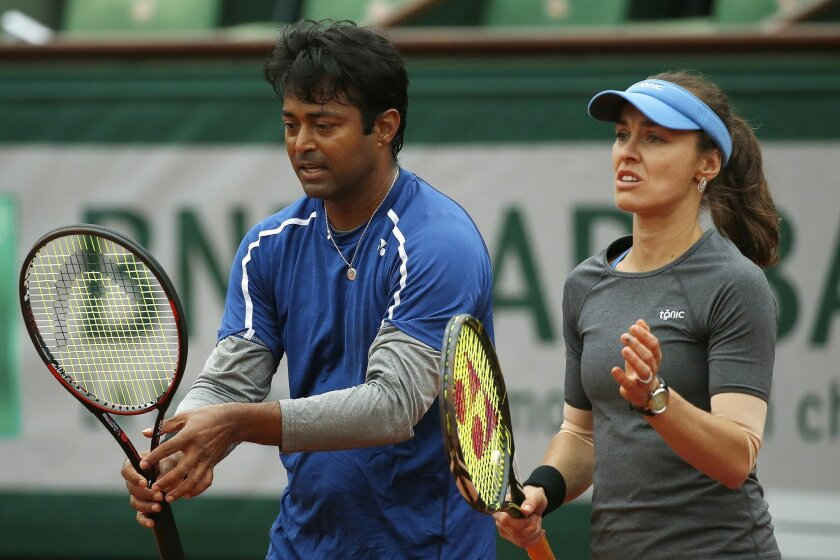 Switzerland's Martina Hingis, right, and India's Leander Paes, left, wait to return the ball in the final of the mixed doubles match of the French Open tennis tournament against India's Sania Mirza and Croatia's Ivan Dodic at the Roland Garros stadium in Paris, France, Friday, June 3, 2016. (AP Pho
