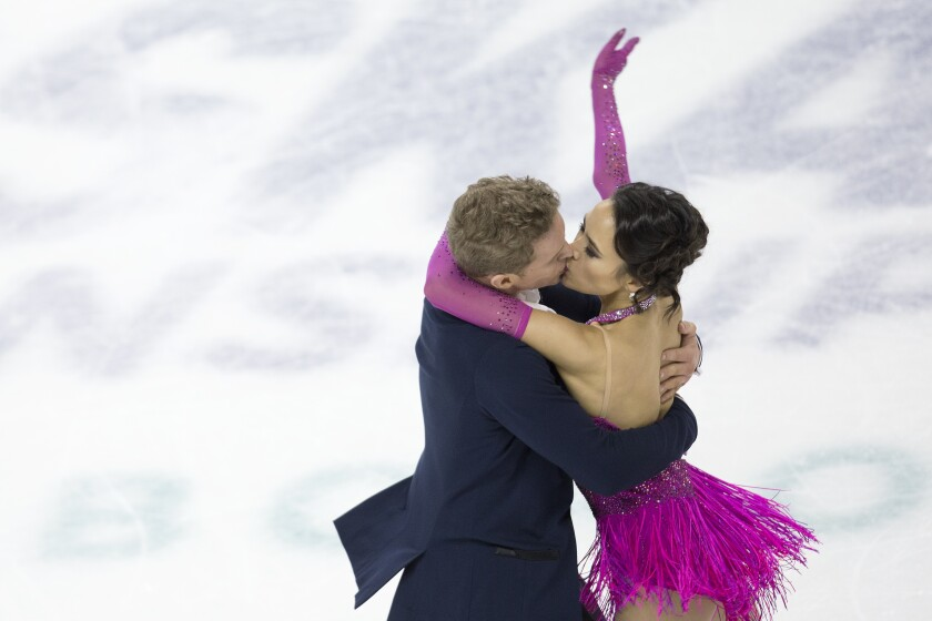 Evan Bates and Madison Chock kiss during their rhythm dance routine Jan. 24, 2020, at the U.S. Figure Skating Championships.