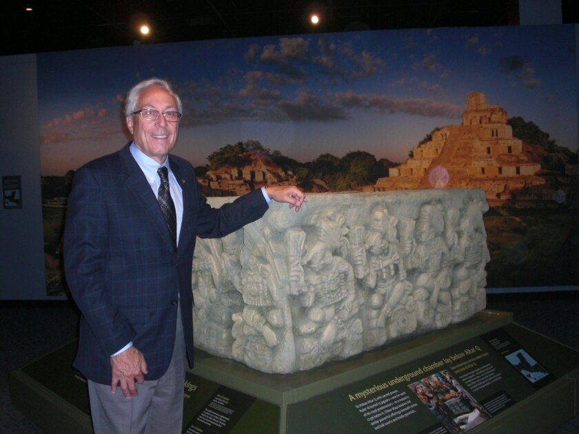 DR. Michael Hager, the NAT president/CEO stands in front of the replica of the altar from Copan, a Mayan site in Hondurus.