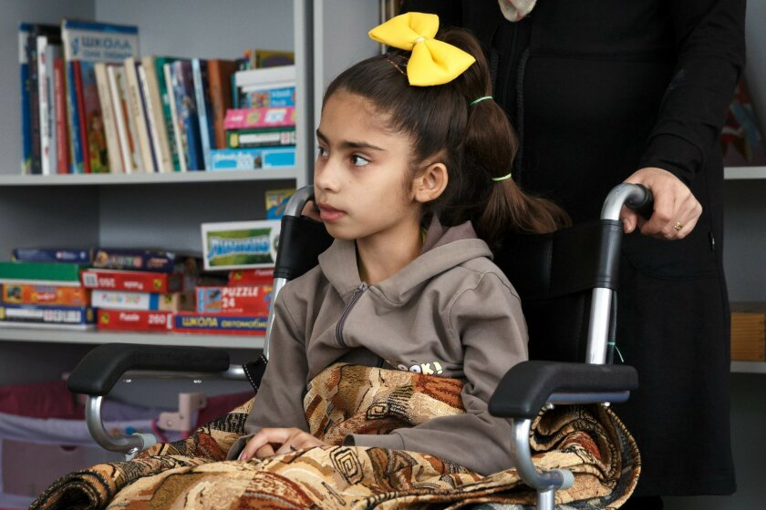 Syrian girl Sidra Zaarur, who lost both legs in the shelling in Aleppo, meets with Russian military cadets visiting her in a hospital for children in Moscow, Friday, June 3, 2016. After suffering from serious traumas Sidra, with her mother, was taken to Moscow for rehabilitation aboard a Russian mi