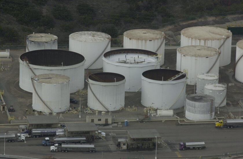 Gasoline storage tanks alongside I-15 and Friars Road near Qualcomm. Earnie Grafton
