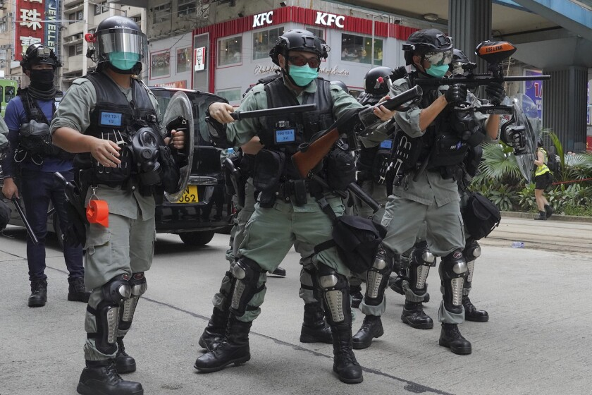 Hong Kong riot police fire tear gas at protesters on Sunday.