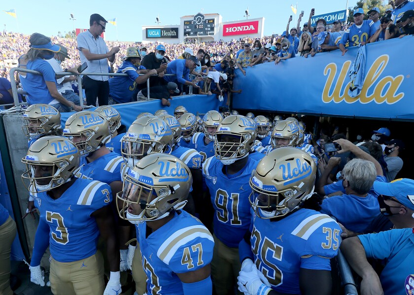 UCLA players prepare to take the field for a game against LSU.