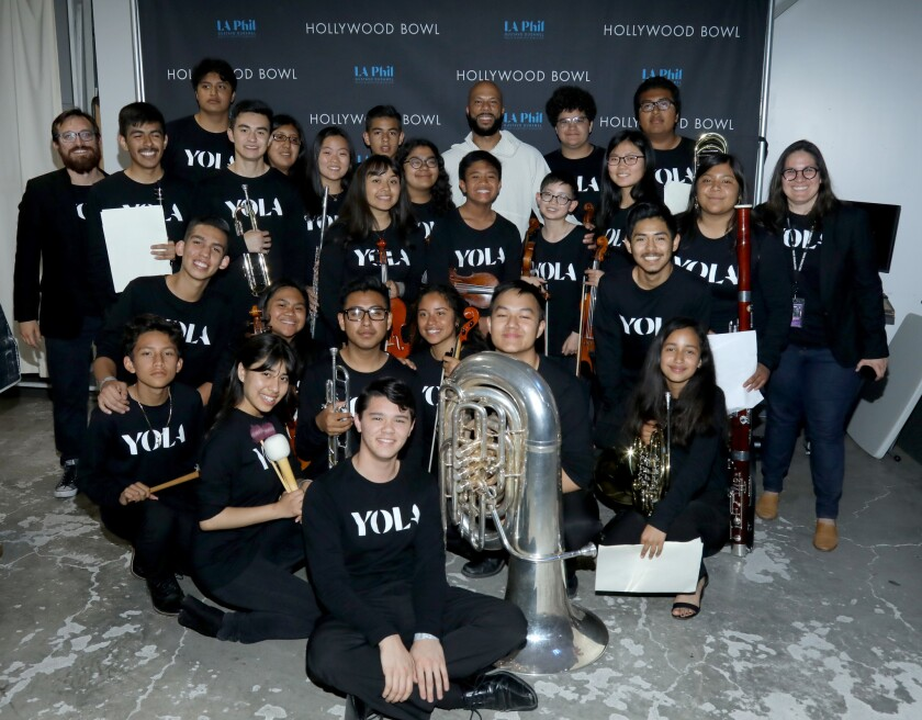 Members of YOLA (the Youth Orchestra of Los Angeles) with rapper Common, back center.