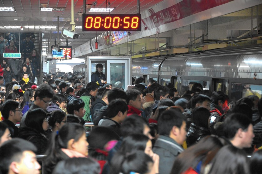 Passengers wait for a train at Sihui East station in Beijing. Officials raised subway fares as much as fourfold in what they said was an effort to reduce overcrowding.