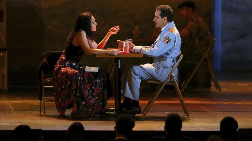 """Katrina Lenk and Tony Shalhoub, from the cast of """"The Band's Visit,"""" perform at the 72nd Tony Awards at Radio City Music Hall on Sunday."""