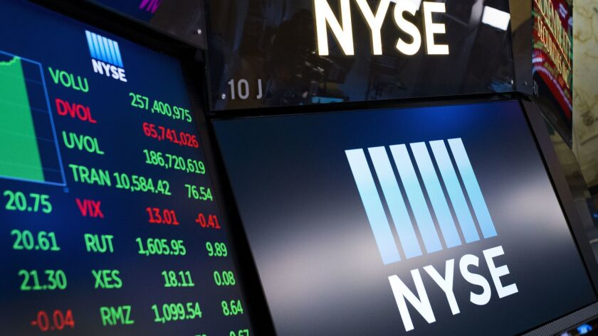 Stock screens are shown at the New York Stock Exchange in this May 10 file photo.