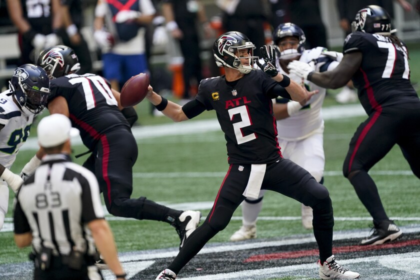 Atlanta Falcons quarterback Matt Ryan (2) works in the pocket against the Seattle Seahawks during the second half of an NFL football game, Sunday, Sept. 13, 2020, in Atlanta. (AP Photo/John Bazemore)