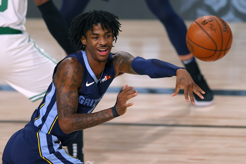 Grizzlies guard Ja Morant passes the ball during a game against the Boston Celtics on Aug. 11, 2020, in Orlando, Fla.