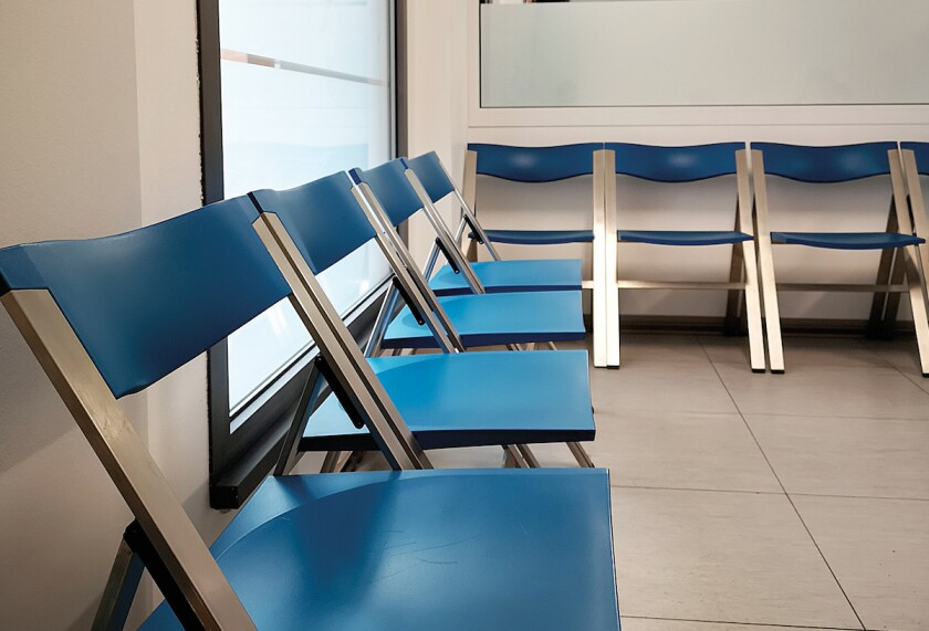waiting room with chairs and feet of people