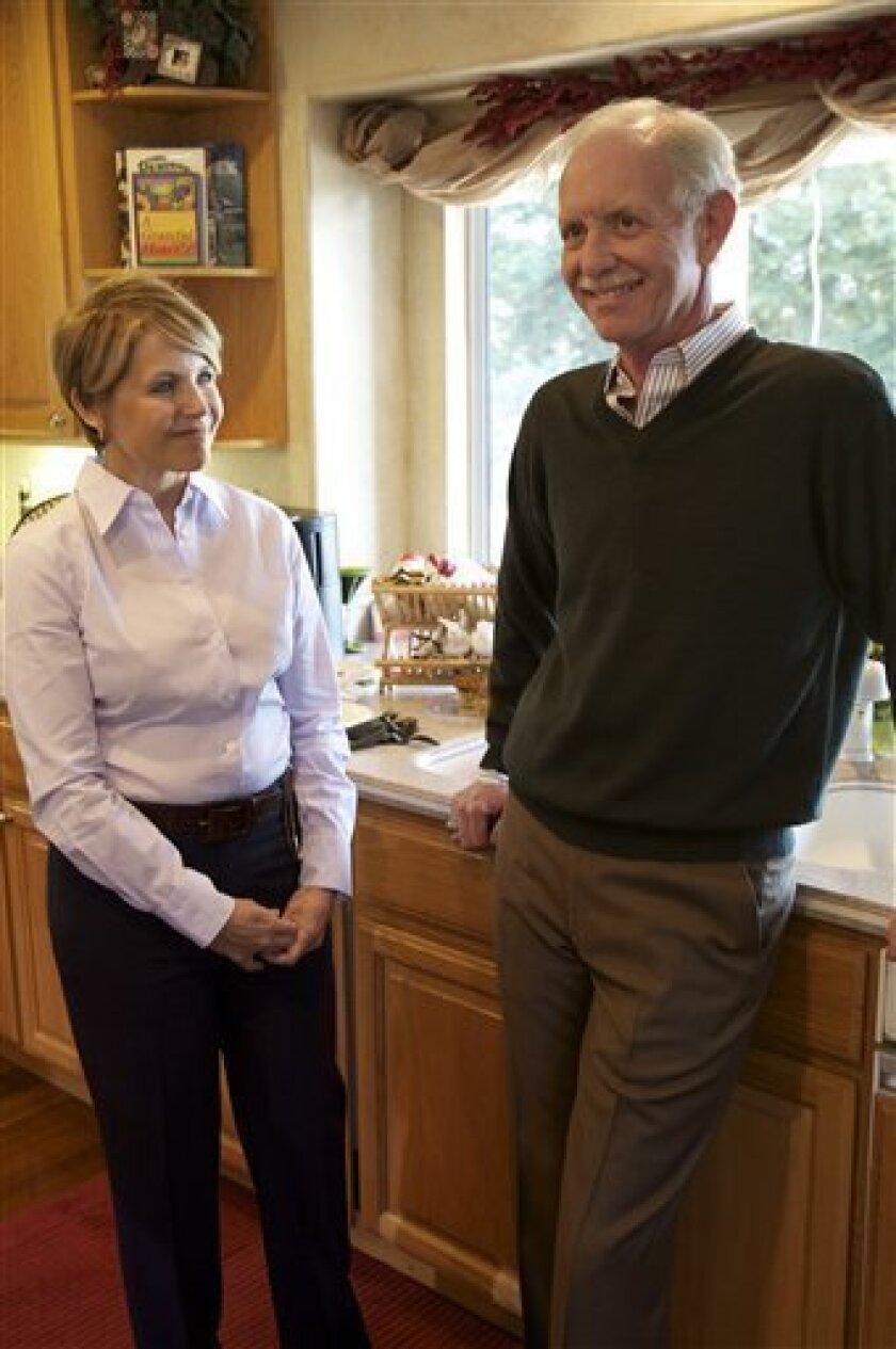 "In this image released by CBS, Capt. Chesley ""Sully"" Sullenberger is shown with Katie Couric at home in his kitchen in Danville, Calif., on Jan. 30, 2009, during his first interview since the U.S. Airways pilot landed his plane on the Hudson River in New York. The interview will be broadcast on ""60 Minutes,"" Sunday, Feb. 8 at 7:00 p.m. EDT on CBS. (AP Photo/CBS, Sam Painter)"