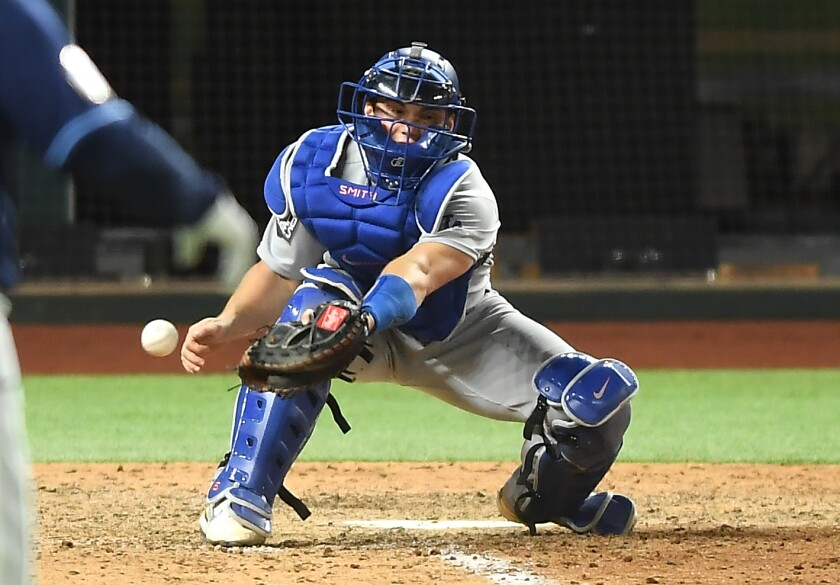 Dodgers catcher Will Smith drops the ball, allowing Tampa Bay's Randy Arozarena to score the winning run.