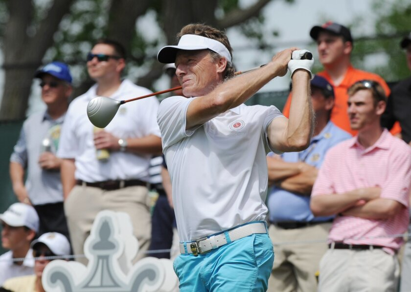 Bernhard Langer tees off on the 18th hole during the first round of the Senior PGA Championship golf tournament at Harbor Shores in Benton Harbor, Mich. (Don CampbellThe Herald-Palladium via AP)