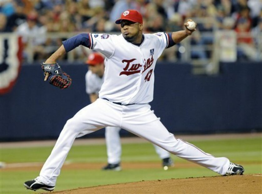 Minnesota Twins' Francisco Liriano pitches against the Detroit Tigers in the first inning of a baseball game Saturday, July 4, 2009 in Minneapolis. (AP Photo/Jim Mone)