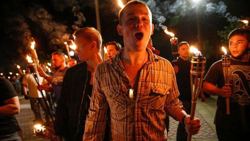 On Friday, multiple white nationalist groups march with torches through the University of Virginia c