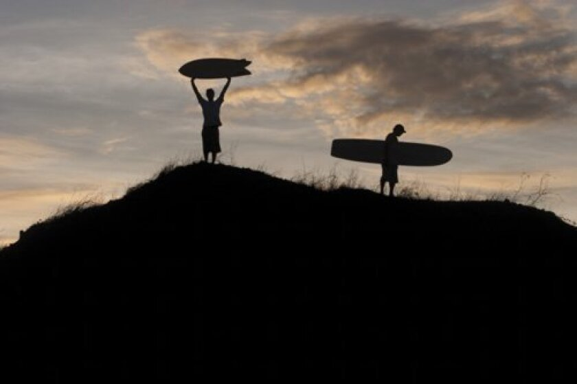 Surfers in the Galapagos Islands