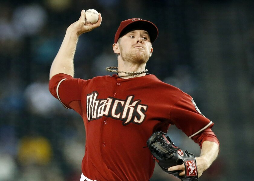 Arizona Diamondbacks' Chase Anderson throws a pitch against the Colorado Rockies during the first inning of a baseball game Sunday, Aug. 31, 2014, in Phoenix. (AP Photo/Ross D. Franklin)