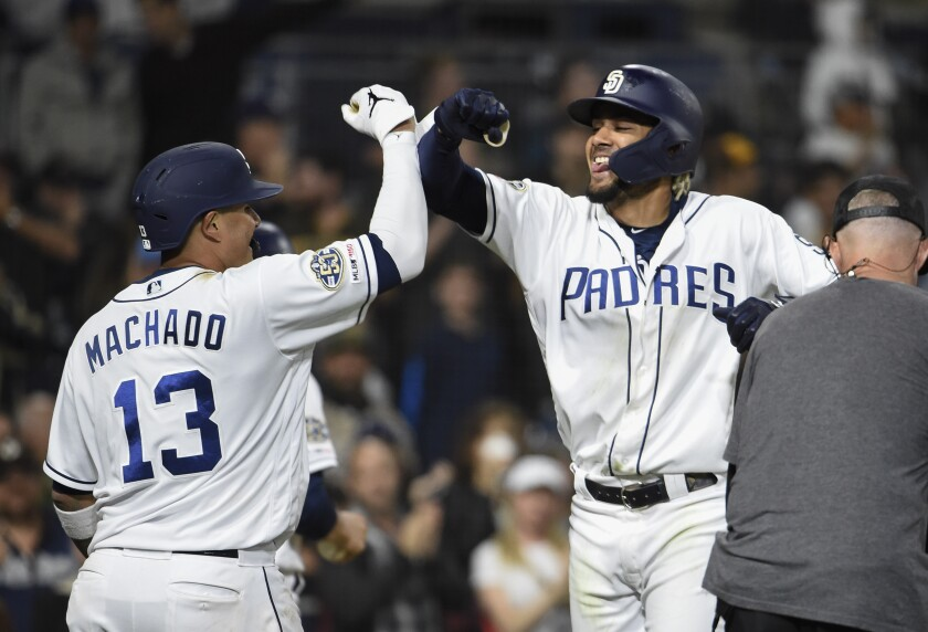 Fernando Tatis Jr., right, is congratulated by Manny Machado after hitting a two-run homer April 1 at Petco Park.