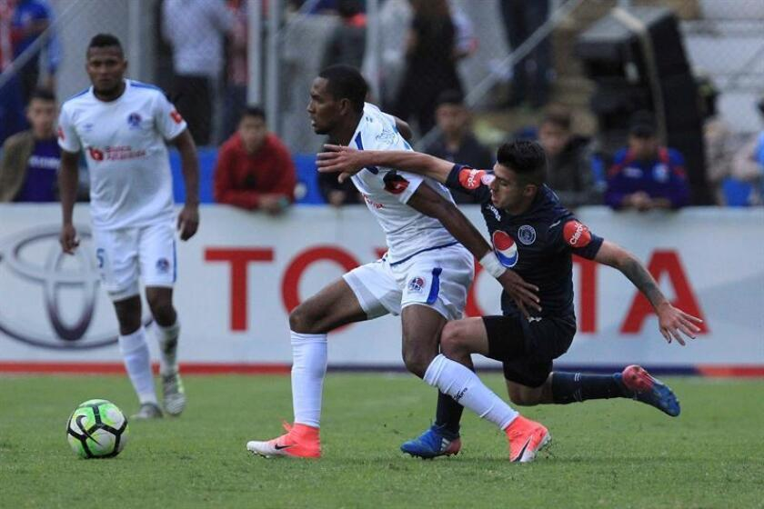 Matias Galvaliz (L) from Motagua vies for the ball with Jerry Bengston (C) from Olimpia in the Honduran Championship final on Dec. 16, 2018 in Tegucigalpa,Honduras. EPA-EFE FILE/Gustavo Amador