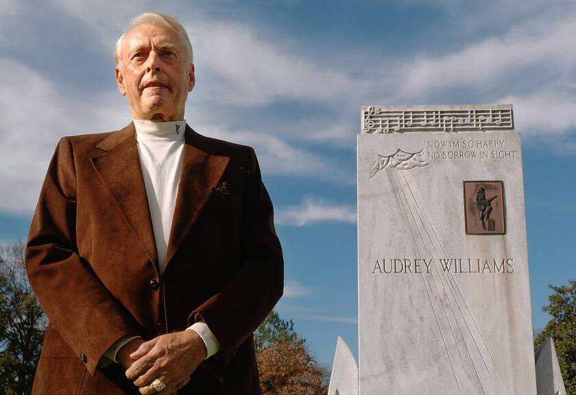 Charles Carr in 2007 at the graves of Hank and Audrey Williams in Oakwood Cemetery in Montgomery, Ala.