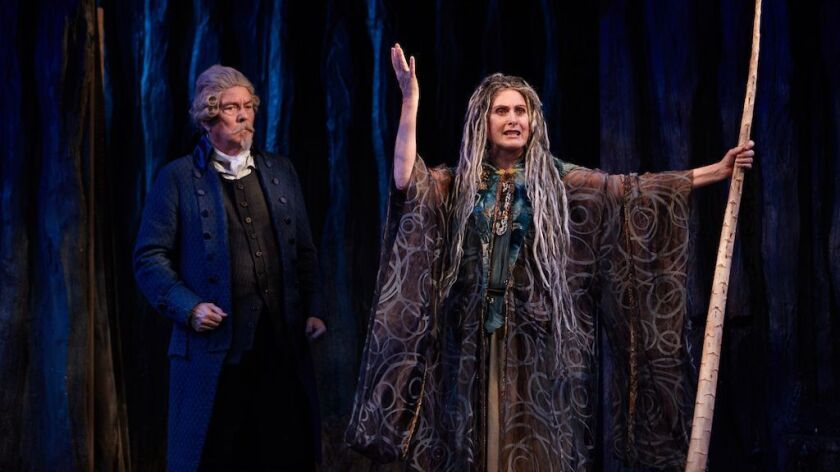 """John Herzog (left) as the Pridamant of Avignon and Kandis Chappell as the sorcerer Alcandre in the North Coast Rep production of Tony Kushner's """"The Illusion."""""""