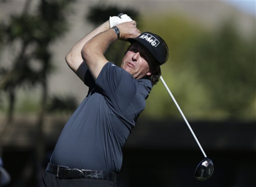Phil Mickelson watches his tee shot on the sixth hole during the first round of the Humana Challenge golf tournament at the La Quinta Country Club in La Quinta, Calif. Thursday, Jan. 17, 2013. (AP Photo/Chris Carlson)