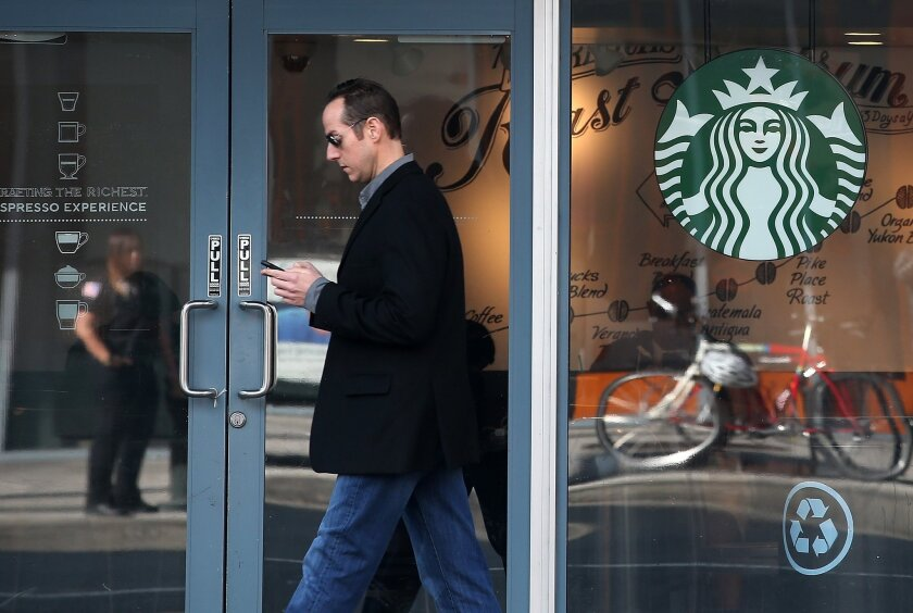 A pedestrian walks by a Starbucks Coffee shop on January 22, 2015 in San Francisco. The Burbank Planning Board has denied a request for the Starbucks at Olive and Verdugo avenues to serve beer and wine.
