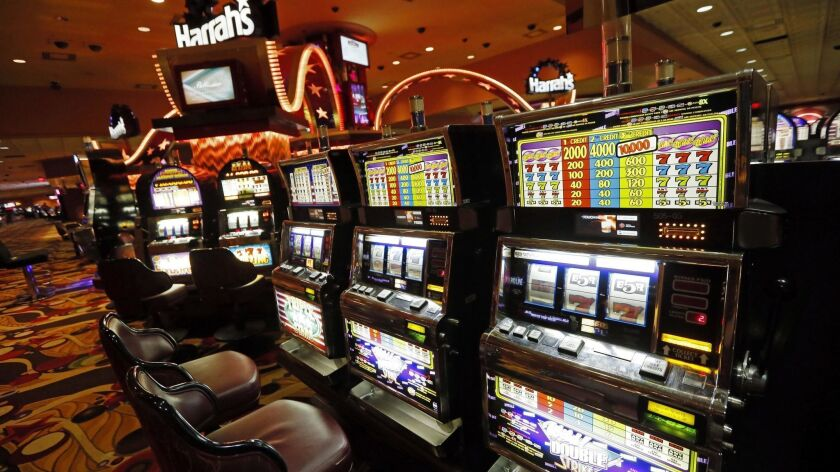 FILE - In this May 12, 2014 file photo, legions of slot machines have few customers at Harrah's Tuni