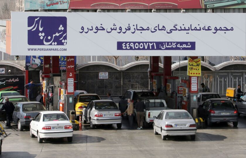 Iranian motorists fill up at a gas station in the capital, Tehran, on Jan. 19, 2016.