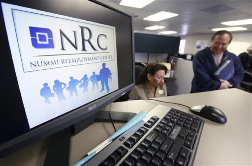 In this photo taken May 27, 2010, an unemployment worker, right, gets help from a counselor at the Nummi Reemployment Center in Fremont, Calif., Thursday, May 27, 2010. Initial claims for jobless benefits fell by the most in two months last week, but remain above levels consistent with healthy job growth.(AP Photo/Paul Sakuma)