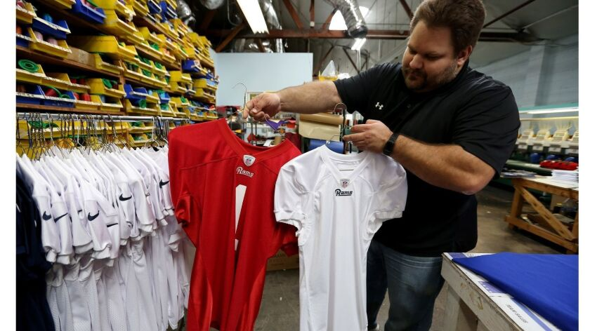 Buddy?s All Stars Athletic Uniforms, Equipment, Lettering marketing manager Scott Talamantes shows t