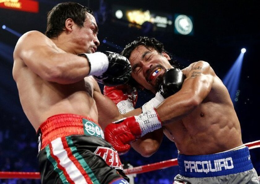 Juan Manuel Marquez lands a left against Manny Pacquiao during their welterweight fight on Saturday night at the MGM Grand Garden Arena in Las Vegas.