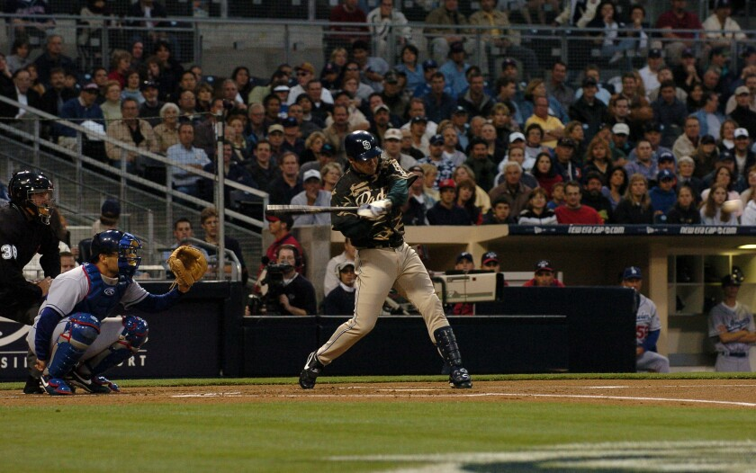 Padres' Mark Loretta unleashes a home run on a pitch from Los Angeles Dodgers starting pitcher Hideo Nomo at Petco Park on April 15, 2004. It was the first home run by a Padres player in the new ballpark.