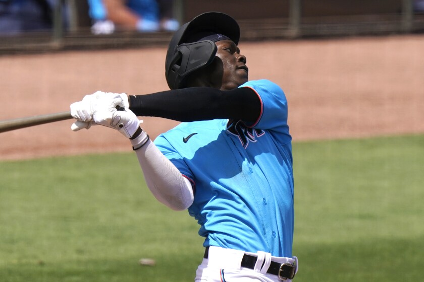 Miami Marlins' Jazz Chisholm hits a solo home run during the fifth inning of a spring training baseball game against the New York Mets, Wednesday, March 17, 2021, in Jupiter, Fla. (AP Photo/Lynne Sladky)