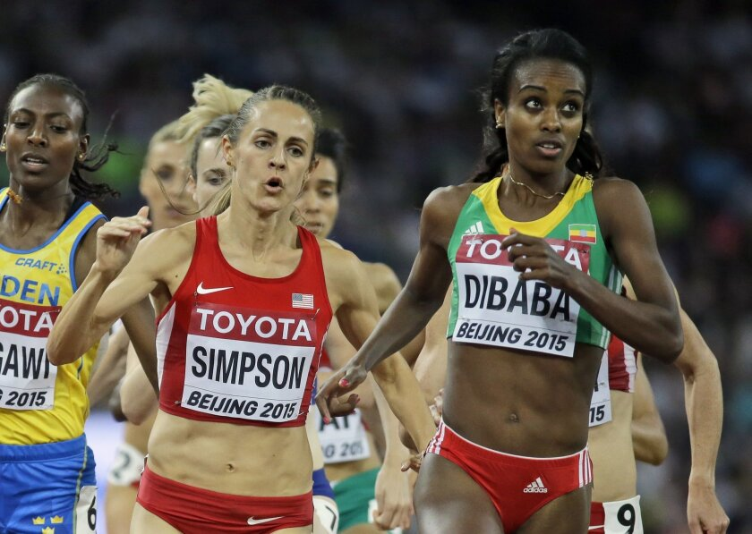 United States' Jennifer Simpson, left, and Ethiopia's Genzebe Dibaba compete in the women's 1500m final at the World Athletics Championships at the Bird's Nest stadium in Beijing, Tuesday, Aug. 25, 2015. (AP Photo/David J. Phillip)
