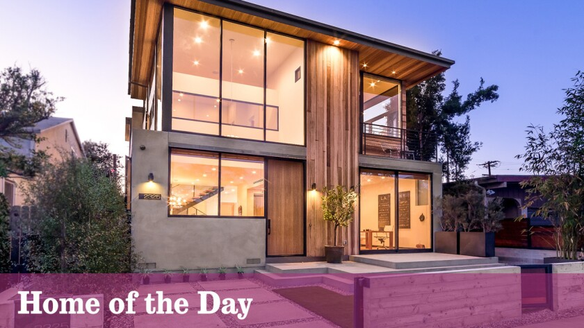 The glass-and-wood contemporary by Mayes Office architecture currently lists for $4 million.