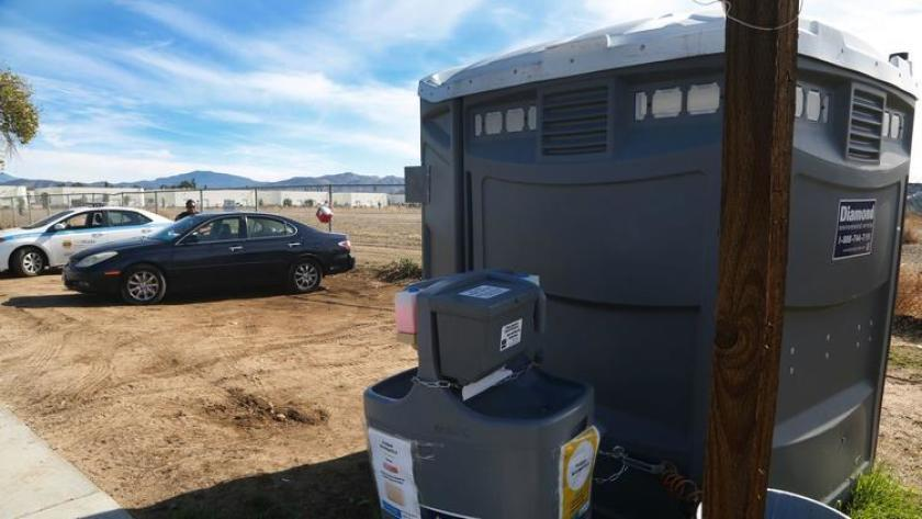 A portable toilet belonging to Diamond Environmental Services. The company, two executives and a technician were indicted Thursday on charges of skirting clean-air rules for their fleet of diesel trucks.