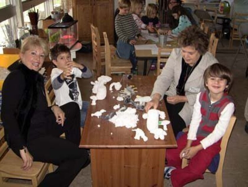 Farideh Perakis and Pouran Tahghigh get hands-on time creating sculptures with their grandchildren during Grandparents and Special Friends Day at The Children's School. Photo: Courtesy