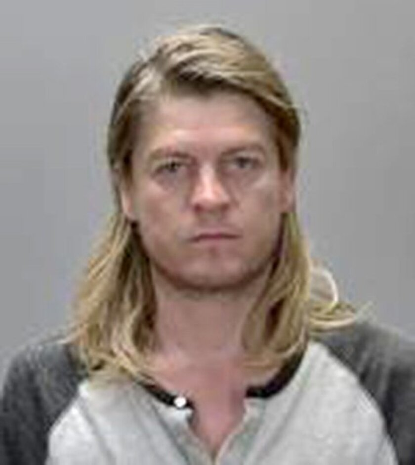 This July 26, 2015 photo provided by the Renville County Jail shows Puddle of Mudd singer Wes Scantlin. The Puddle of Mudd singer faces charges of drunken driving and fleeing police after a chase in Minnesota that reached speeds of about 100 mph. Scantlin appeared Monday, July 27, in Renville County court on charges of felony fleeing police in a motor vehicle; refusing to submit to a chemical test; and DWI. (Renville County Jail/Star Tribune via AP)