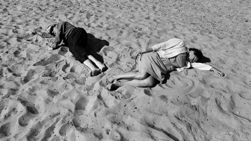 """Inspired by Edward Weston, Hernandez caught figures on the beach in photos such as """"Santa Monica #14,"""" from 1970."""