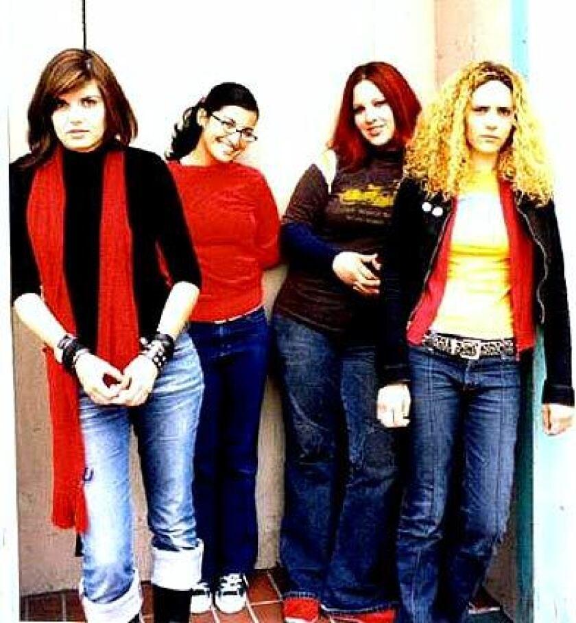 Nicolette Vilar, left, Michelle Rangel, Betty Cisneros and Aixa Vilar in 2005.