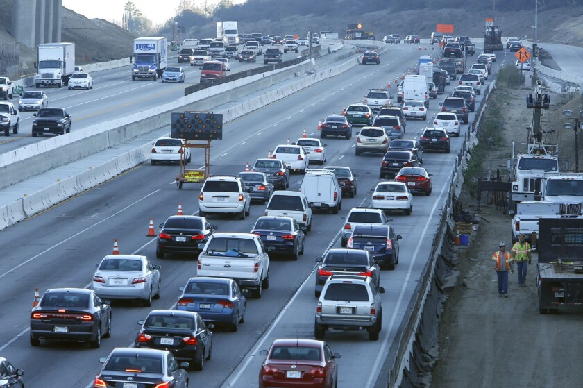 Motorists travel during morning rush hour on a section of the Sepulveda Pass. LA County voters could be asked in 2015 to fund a toll highway and rail line through the pass.