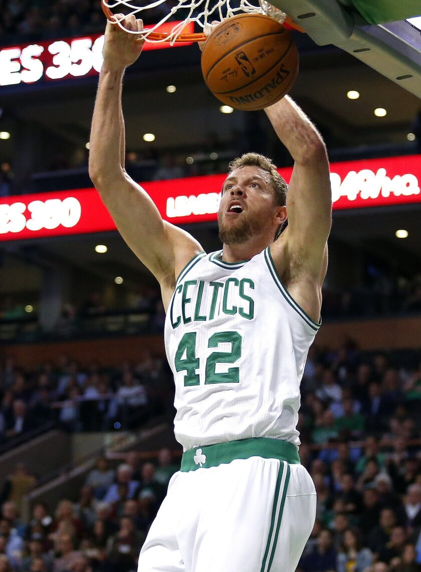 FILE - In this Dec. 15, 2015, file photo, Boston Celtics' David Lee dunks against the Cleveland Cavaliers during the third quarter of a NBA basketball game in Boston. The veteran forward went through his first full workout with the Dallas Mavericks on Tuesday, Feb. 23, 2016, and should make his Dallas debut Wednesday night at home against Oklahoma City. Lee, who was averaging 7.1 points with career lows of 4.3 rebounds and 15.7 minutes per game in Boston, was waived by the Celtics last week. (AP Photo/Winslow Townson, File)