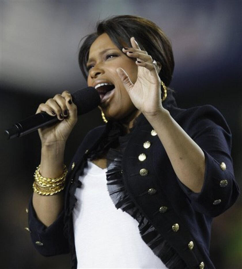 Jennifer Hudson sings the national anthem before the NFL Super Bowl XLIII football game between the Arizona Cardinals and Pittsburgh Steelers, Sunday, Feb. 1, 2009, in Tampa, Fla. (AP Photo/Ross D. Franklin)