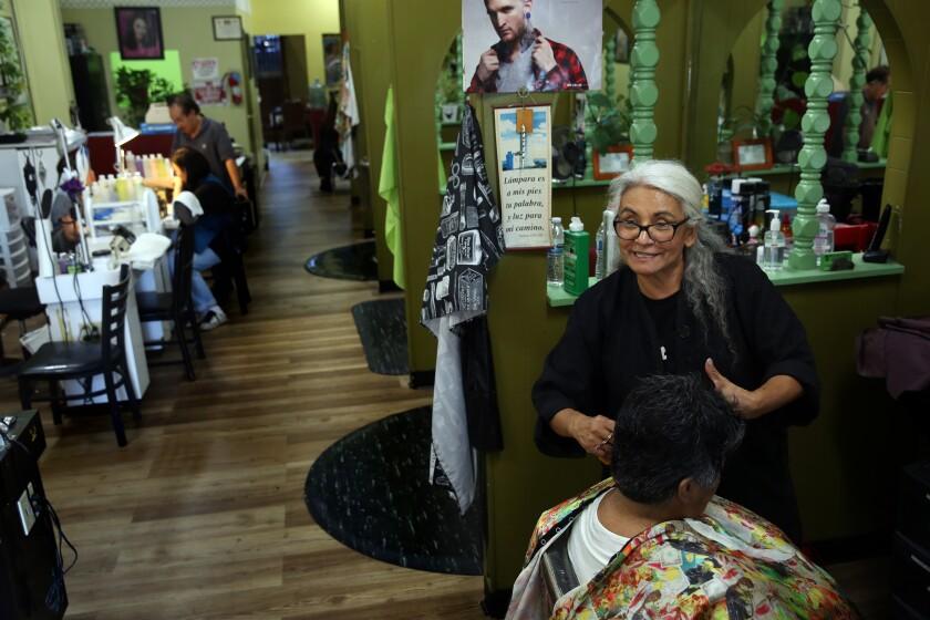 Maria Garcia does Evertina Medina's hair