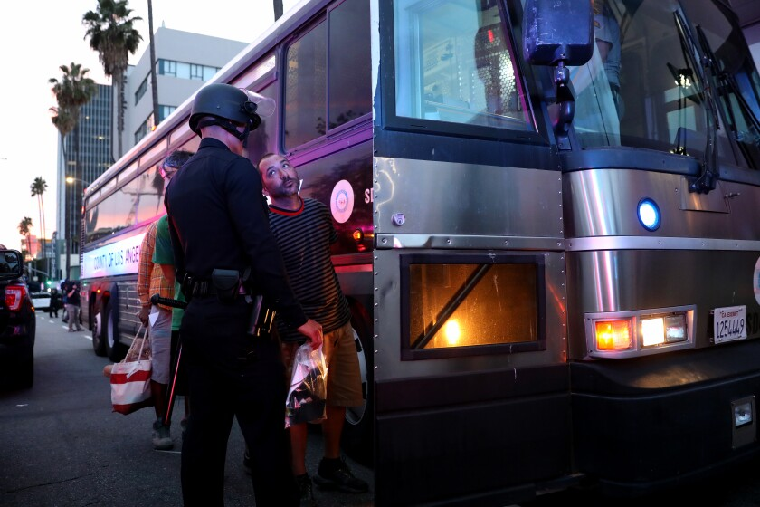 LOS ANGELES, CA - JUNE 01: Protestors arrested for violating curfew along Sunset Blvd. at Gower in Hollywood on Monday, June 1, 2020 in Los Angeles, CA. (Gary Coronado / Los Angeles Times)