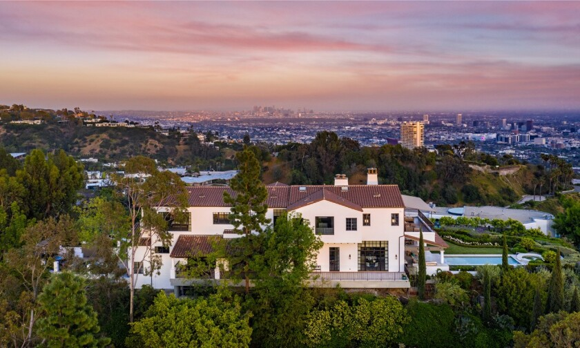 Built in 2001, the hilltop home expands to a scenic backyard with a lawn, swimming pool and sweeping city views.