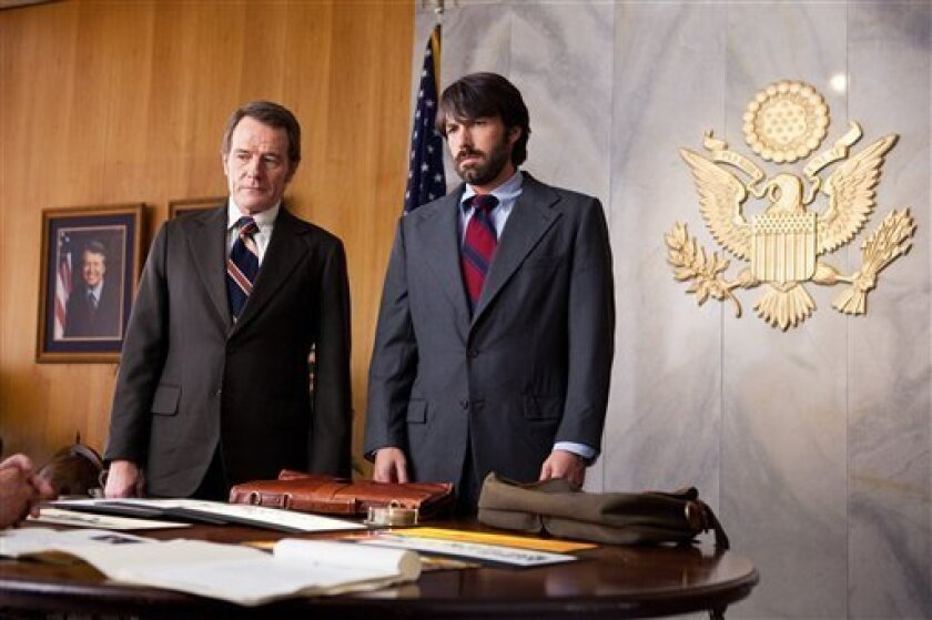 """FILE - This undated publicity film image released by Warner Bros. Pictures shows Bryan Cranston, left, as Jack O'Donnell and Ben Affleck as Tony Mendez in """"Argo,"""" a rescue thriller about the 1979 Iranian hostage crisis. """"Argo"""" earned a adapted screenplay nomination from the Writers Guild on Friday, Jan. 4, 2013, for outstanding screen writing. (AP Photo/Warner Bros., Claire Folger, File)"""