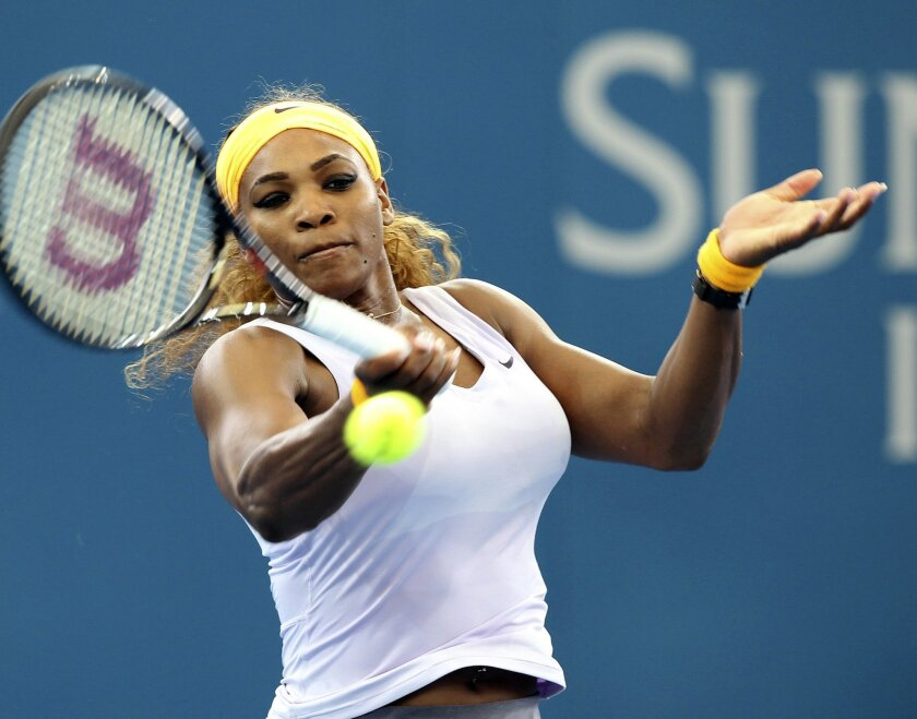Serena Williams of the U.S. plays a shot in her quarter final match against Dominika Cibulkova of Slovakia during the Brisbane International tennis tournament in Brisbane, Australia, Thursday, Jan. 2, 2014. (AP Photo/Tertius Pickard)