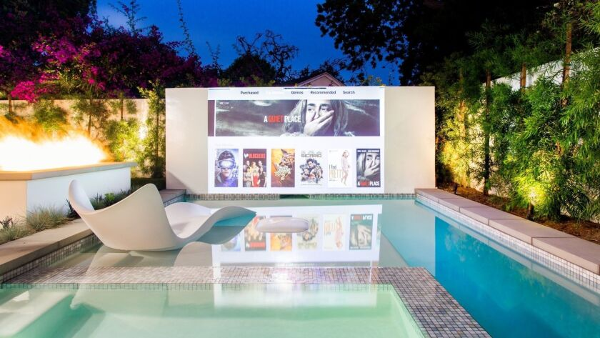 The swimming pool doubles as a movie theater at this new Mar ...